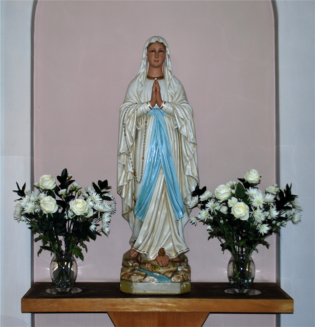 The statue of Our Lady.